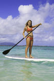 Adolescent sur son paddleboard Photo libre de droits