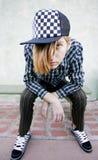 Adolescent sur un banc Photo stock
