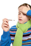 Adolescent temperature. The boy took it for its thermometer Royalty Free Stock Image