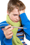 Adolescent temperature. The boy took it for its thermometer Stock Photography