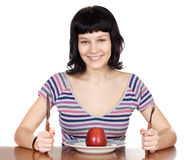 Adolescent to diet. Eating red apple a over white background stock photo
