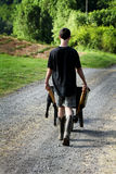 Adolescent travaillant Photographie stock libre de droits