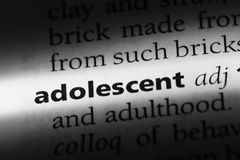 Adolescent. Word in a dictionary.  concept royalty free stock photography