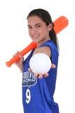 Adolescente adorable con en el uniforme con el palo y la bola del juguete Foto de archivo