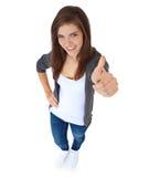 Adolescente affichant des pouces vers le haut Photographie stock