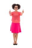 Adolescente afroamericano hermoso feliz en pulgares rosados para arriba Imagen de archivo