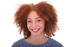 Adolescente afroamericano joven aislado en el fondo blanco Imagenes de archivo