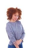 Adolescente afroamericano joven aislado en el fondo blanco Imagen de archivo