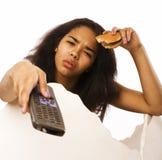 Adolescente afroamericano joven con el telecontrol y Imagen de archivo