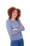 Adolescente afroamericano joven que mira para arriba, aislado en pizca Foto de archivo