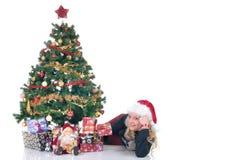 Adolescente al lado de Navidad tres Imágenes de archivo libres de regalías