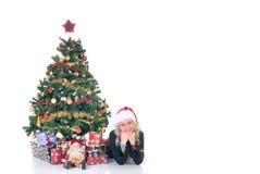 Adolescente al lado de Navidad tres Fotos de archivo