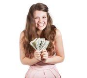 Adolescente alegre com dólares em suas mãos Fotografia de Stock Royalty Free