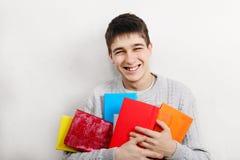Adolescente alegre con libros Fotografía de archivo