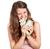 Adolescente alegre con los dólares en sus manos Imagen de archivo