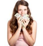 Adolescente alegre con los dólares en sus manos Foto de archivo libre de regalías