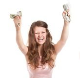 Adolescente alegre con los dólares en sus manos Fotos de archivo libres de regalías