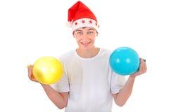 Adolescente alegre con los globos Fotos de archivo