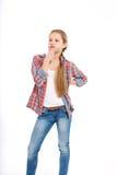 Adolescente alegre joven en el fondo blanco Fotografía de archivo libre de regalías