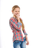 Adolescente alegre joven en el fondo blanco Imagen de archivo