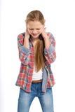 Adolescente alegre joven en el fondo blanco Imagenes de archivo