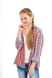 Adolescente alegre joven en el fondo blanco Foto de archivo libre de regalías