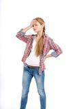 Adolescente alegre joven en el fondo blanco Imágenes de archivo libres de regalías
