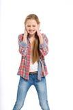 Adolescente alegre joven en el fondo blanco Imagen de archivo libre de regalías