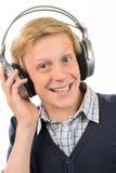 Adolescente alegre que escucha la música Imagen de archivo libre de regalías