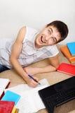 Adolescente alegre que hace la preparación Imagen de archivo libre de regalías