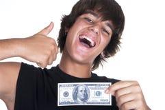 Adolescente allegro con le fatture di $ 100 Immagine Stock