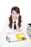 Adolescente allo scrittorio del banco Fotografia Stock