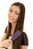Adolescente americano asiático hermoso cepillando su sonrisa del pelo Foto de archivo libre de regalías