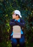 Adolescente annoiato con libri Fotografia Stock