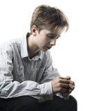 Adolescente apenado aislado en blanco Imagen de archivo libre de regalías