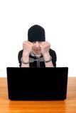Adolescente arrestado con el ordenador portátil Imágenes de archivo libres de regalías