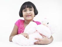 Adolescente asiático con su muñeca Imágenes de archivo libres de regalías