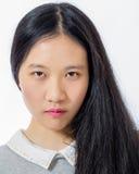 Adolescente asiático de mirada serio Fotografía de archivo libre de regalías