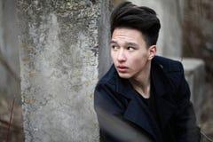Adolescente asiático del muchacho en naturaleza Imagen de archivo libre de regalías