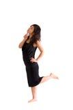 Adolescente asiático en la falda negra aislada Foto de archivo