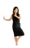 Adolescente asiático en la falda negra aislada Fotografía de archivo