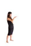 Adolescente asiático en la falda negra aislada Imagen de archivo libre de regalías