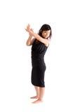 Adolescente asiático en la falda negra aislada Fotos de archivo