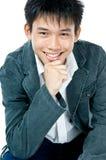 Adolescente asiático esperto feliz imagem de stock royalty free