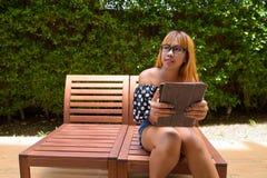 Adolescente asiático joven que se relaja en casa Fotografía de archivo