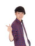 Adolescente asiático que señala el finger Foto de archivo libre de regalías