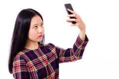 Adolescente asiático que toma el selfie Fotografía de archivo libre de regalías