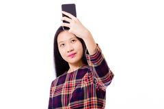Adolescente asiático que toma el selfie Foto de archivo libre de regalías