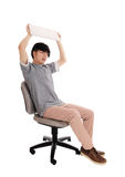 Adolescente asiatico che fracassa il suo computer portatile Immagine Stock