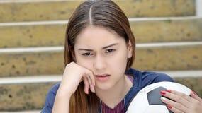 Adolescente atlético triste Foto de archivo